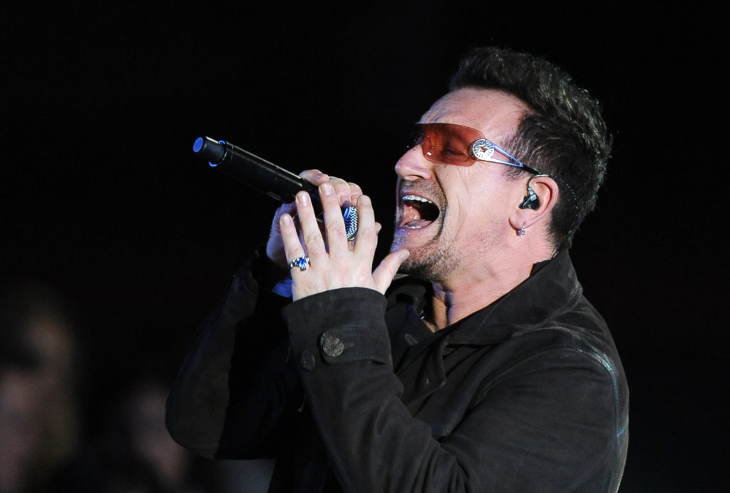 """Bono performs at the Clinton Foundation's """"Decade of Difference"""" concert on October 15, 2011 at the Hollywood Bowl in Hollywood, California. The concert celebrates 10 years of the former US president's Clinton Foundation. RESTRICTED TO EDITORIAL USE AFP PHOTO / ROBYN BECK (Photo credit should read ROBYN BECK/AFP/Getty Images)"""